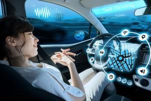 woman riding autonomous car. self driving vehicle. autopilot. automotive technology.