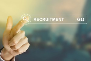 business hand clicking recruitment button on search toolbar with vintage style effect